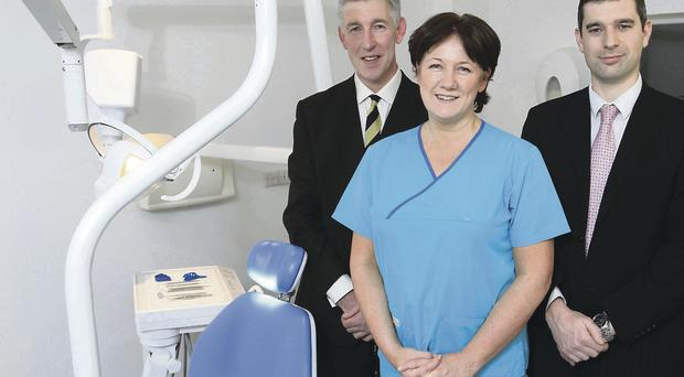 Practice manager of Smiles Dentalcare Richard Pearce with dentist Fiona Doherty and Philip McNeill, business manager of Ulster Bank