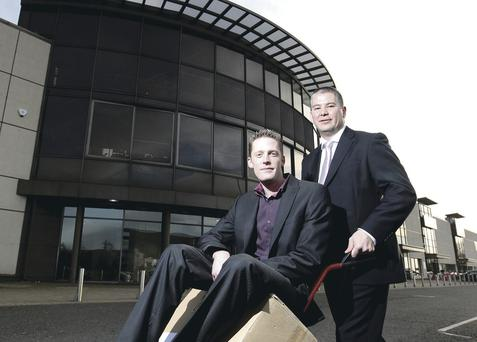 Lee Horsburgh, the general manager of Belfast Furniture Mall, and Simon Piper, MD, of Belfast Furniture Mall, at the former Fultons store at Balmoral Plaza yesterday