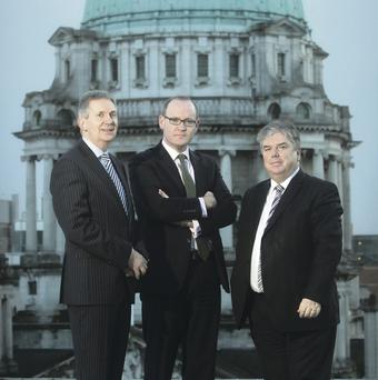 Seven Square's founding directors David Rea (left) and Sam Curry (right) are joined by Stephen Felle, managing director of Davy Private Clients NI