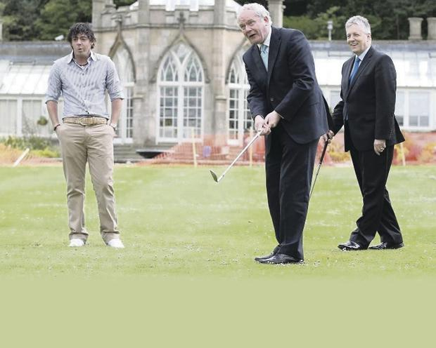 First Minister Peter Robinson and deputy First Minister Martin McGuinness, pictured with Rory McIlroy