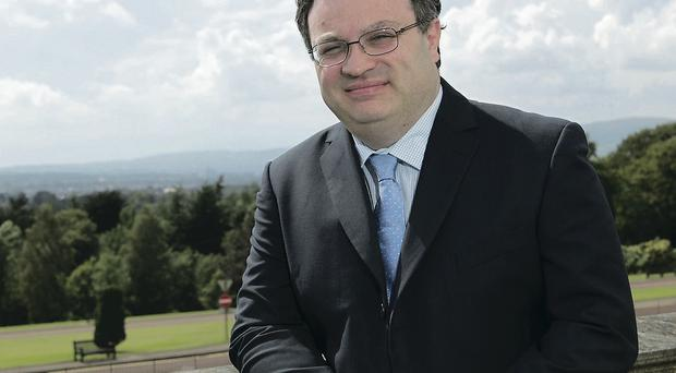 Dr Stephen Farry says that businesses must upskill to succeed