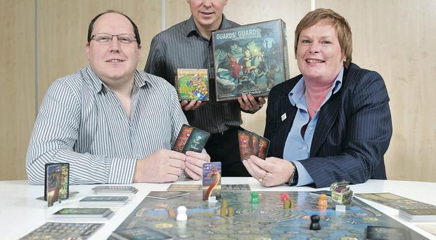 Leonard Boyd and David Brashaw of Backspindle Games with Dr Vicky Kell of Invest NI