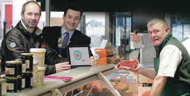 Paul Graham, chief executive, Phlok with John Minnis, president of Holywood Chamber of Commerce and Stevie Moore of Orr's Butchers