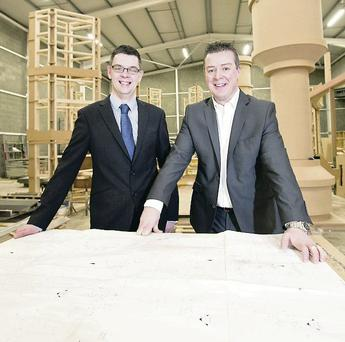 Dominic O'Neill, First Trust Bank (l) and Colm O'Farrell , managing director of The Deluxe Group, at the company's new premises