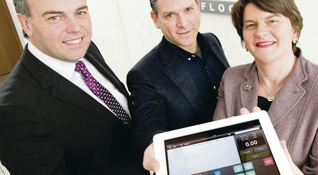 Minister Arlene Foster meets Alastair Hamilton (left) and Jason Richelson, founder and CEO, during a visit to ShopKeep POS's new office