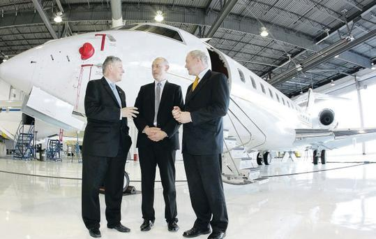 Peter Robinson and Martin McGuinness with Stephen McCullough from Bombardier during their visit to Canada