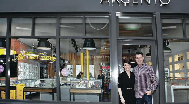 Argento chief executive Pete Boyle with managing director Emma Filmer outside the company's Lisburn store