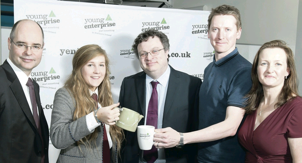 Minister Dr Stephen Farry with Gregory S Burton, US consul general in Belfast; Carol Fitzsimons, chief executive of Young Enterprise NI; Aoife Lavery, a pupil at Victoria College, Belfast, and Oscar Woolley, founder of Suki Tea, at the Food and Drink Masterclass at the e3 campus in Belfast