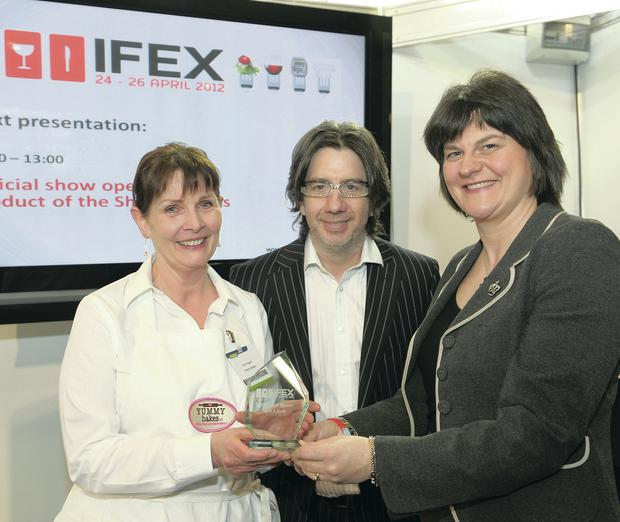 Anna Taggart receives an award for best product from restaurateur Michael Deane and Enterprise Minister Arlene Foster at the IFEX in 2012