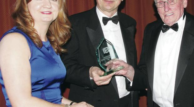IET president Jayne Brady joined Andy Hopper (centre), co-founder of Acorn Computers and a past president, as he presented the first Northern Ireland Engineering Excellence Award to Wrightbus co-founder William Wright (right)
