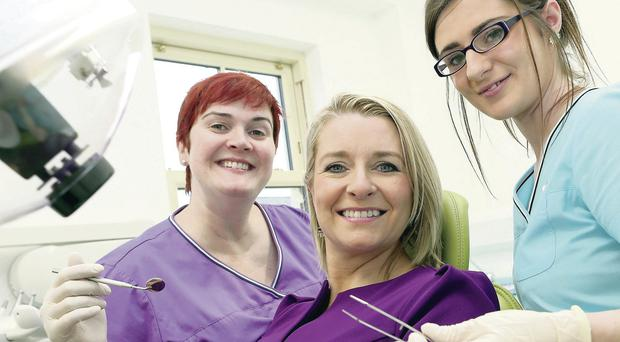 Monica O'Reilly (left), dentist at Delicate Dental, and Sinitta Phair (right), dental nurse, mark the investment with Shauna Burns, head of Ulster Bank's Mid Ulster and Fermanagh Business Centre