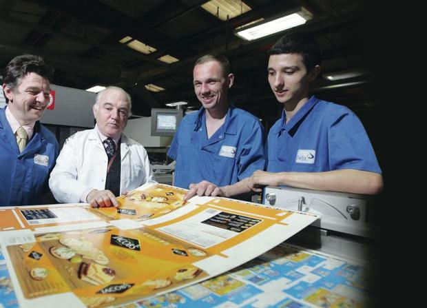 Delta print managing director, Terry Cross, with young apprentices, Kieran Magill and Jason Ali, and Fergal Doyle, HR manager at Delta Matt Mackey/presseye