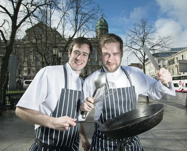 Brothers Martin and Daniel Courtney celebrate the launch of their new restaurant, Stix and Stones, in Belfast city centre