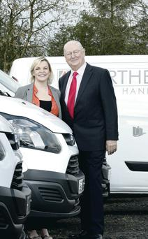 Ogilvie's Jim Humphreys delivers the new fleet to Sinead McCarry Bogle of Northern Materials