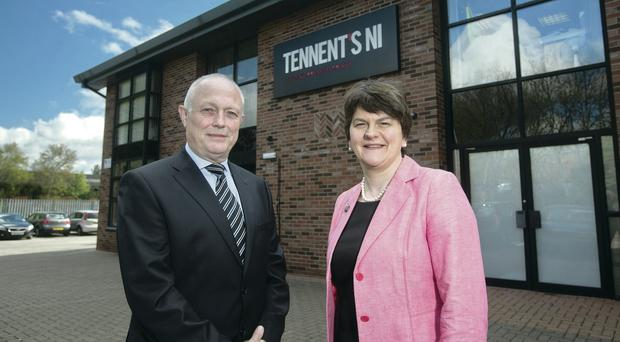 Tom McCusker, MD of C&C Group Ireland and Tennent's Northern Ireland, and Enterprise Minister Arlene Foster, outside the firm's Boucher Road premises