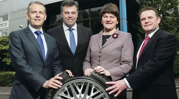 Celebrating the news at Schrader Electronics Ltd's Antrim facility are (from left) Stephen McClelland, Schrader Electronics managing director, Alastair Hamilton, chief executive, Invest NI, Enterprise Minister Arlene Foster and Graeme Thompson, Schrader