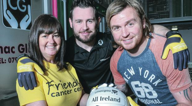 Tyrone GAA star Owen Mulligan (right) joins Claire Hogarth, events and community fundraising manager at Friends of the Cancer Centre, and Ryan O'Neill from Cmac Gloves, as they launch the unique new GAA gloves in aid of the local charity yesterday