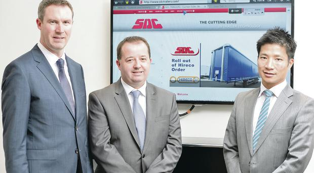 SDC vice-chairman Darren Donnelly and managing director Mark Cuskeran with Tony Wan of Hireco welcoming the £10m contract