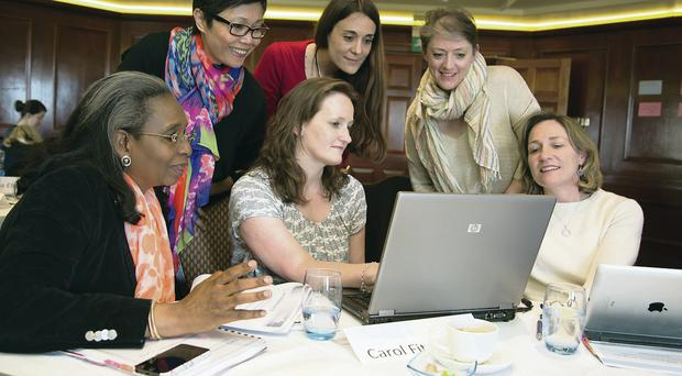 From left: Ibukun Awosika, founder and chief executive officer, Chair Centre Group (Nigeria), Nurlan Silitonga, director, Angsamerah Institution (Indonesia), Carol Fitzsimons, CEO, Young Enterprise Northern Ireland (foreground on computer), Gaella Alexandra Gottwald, director, Croatian Association of Artists (Croatia), Kathleen Holland, founding partner, KMH Associates (Canada) and Katy Knox, senior vice president, Bank of America