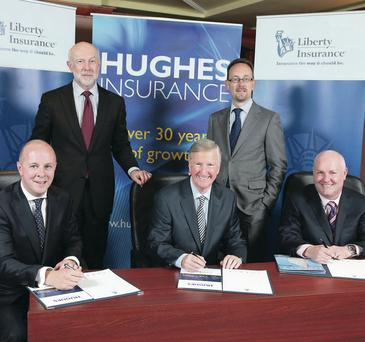 Announcing Liberty Mutual Insurance Group's acquisition of Hughes Insurance are (from left) Gareth Brady, chief executive, Hughes Insurance; Joe Hamilton, chief strategy and business development officer, Liberty Mutual Insurance; Leslie Hughes, chairman, Hughes Insurance; Pat O'Brien, chief executive officer, Liberty Insurance and Gerry Shearer, personal lines director, Hughes Insurance