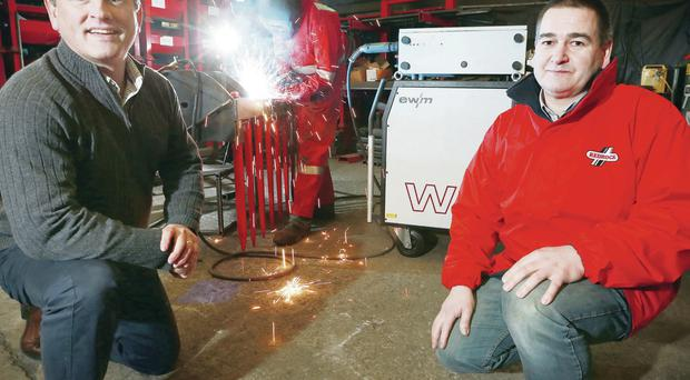 Geoff Baird (left), managing director of Craigmore, joins Alan Smyth, from Redrock, to marks the purchase of five welding machines