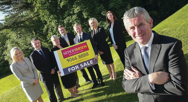Simon Brien, director of Simon Brien Residential, with management team (from right) Caroline McGovern, Ciara Crawford, David Menary, Mark Leinster, Karen Wilson, Martin Mallon and Laura-Ann Barr