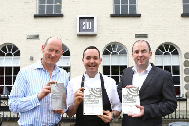 Alan Reid (left), owner of Shu, joins head chef Brian McCann and manager Julian Henry to celebrate its latest best restaurant accolade