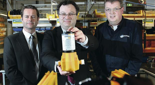 Employment Minister Stephen Farry (centre) with Whale Pumps chief executive Patrick Hirst (right) and Parity Solutions operations manager David McComb