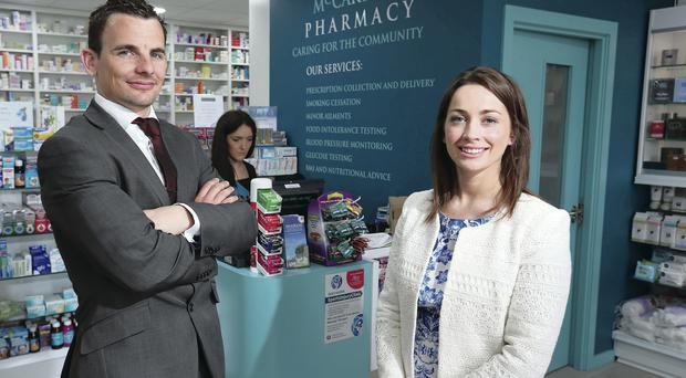 Danny Hughes, Danske Bank acquisition manager, with Gemma McCartan, owner of McCartan's Pharmacy
