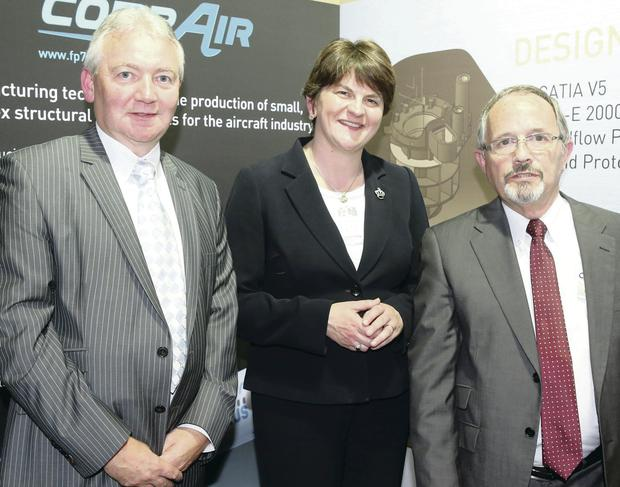 Enterprise Minister Arlene Foster is joined by sales manager James Knowles (left) and technical sales manager Eugene Taylor of Denroy Plastics at Farnborough Airshow yesterday