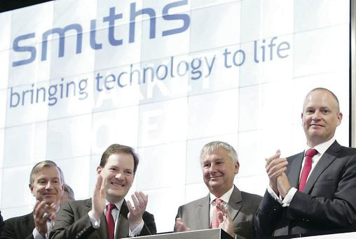 Smiths Group chief executive Philip Bowman (second from the right) marks the centenary of the listing of the company with representatives of the London Stock Exchange
