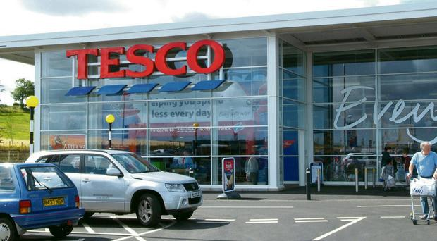 The price war raging in Britain's supermarket aisles forced Tesco into drastic action yesterday following another damaging warning over annual profits