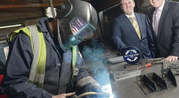 Co Londonderry manufacturing company SJC Hutchinson Engineering has been named has been named best newcomer in the first Investors in People Awards. Managing director Mark Hutchinson (l) celebrated the accolade with Martin Clarke, economic development officer of Coleraine Borough Council
