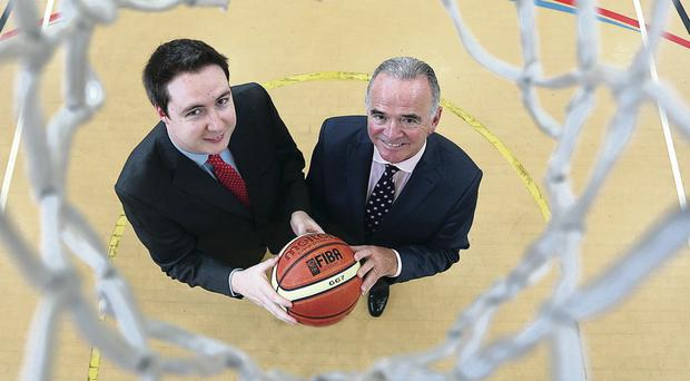 Basketball Direct owner Niall McDermott (left) with UCI chief executive, Harry McDaid