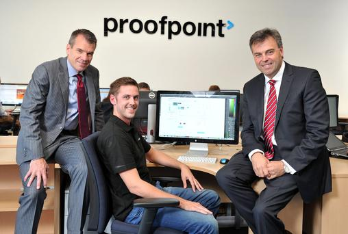 Alastair Hamilton, CEO of Invest Northern Ireland speaking with software engineer, David Saunders and Gary Steele (left), CEO of Proofpoint Inc at the announcement of 94 new jobs at Proofpoint based at Weaver Court, Belfast