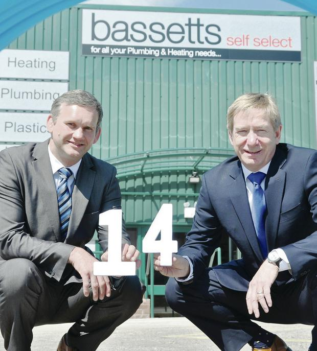 Bassetts managing directors Stephen Bassett and Alan Wright at the new Bassetts store on the Springfield Road in west Belfast – the company's 14th in Northern Ireland