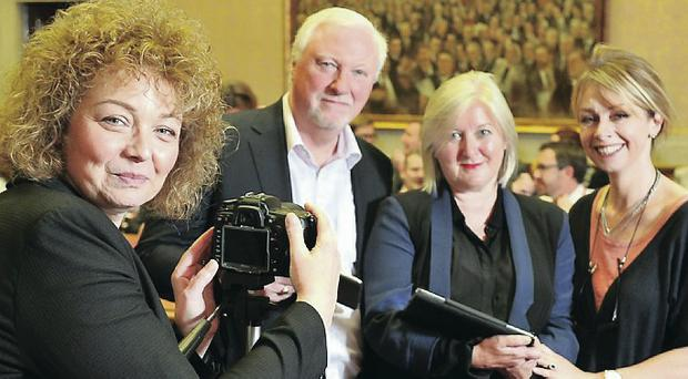 Say cheese: Culture Minister Carál Ní Chuilín with Ian Kennedy, Kate O'Connor and Anne Stirling of Creative Skillset NI at the first meeting of the forum
