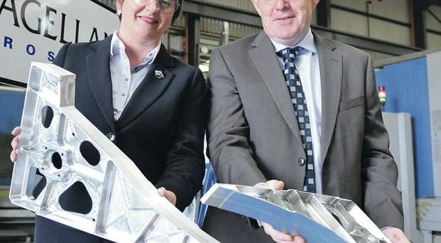 Flying high: Enterprise Minister Arlene Foster yesterday congratulates Haydn Martin of Magellan on the aerospace company's £6m expansion