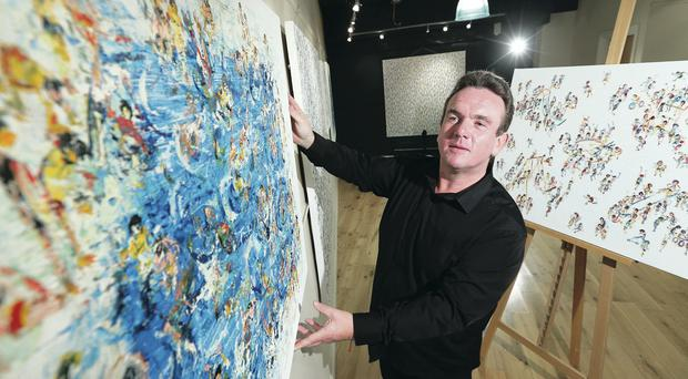 Art dealer Charles Gilmore yesterday puts the finishing touches to the show of new works by Irish contemporary artist Stephen Forbes