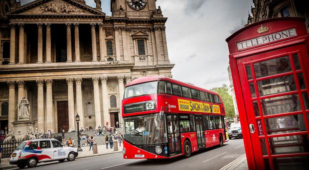 A Routemaster bus, built by Ballymena firm Wrightbus, driving through the streets of central London