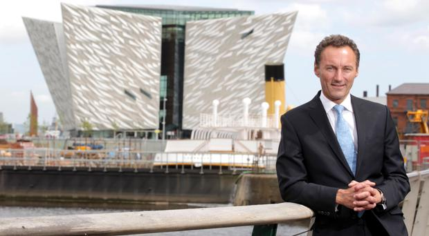 Titanic Quarter boss David Gavaghan with the Titanic Belfast building behind him