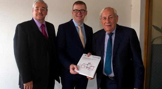 Finance Minister Simon Hamilton was presented with a copy of the FSB report by Roger Pollen (left) and FSB national chairman, John Allan