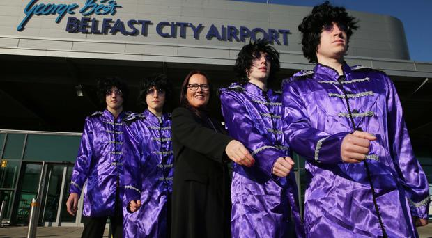 Flybe's UK regional general manager Andrea Hayes steps out with 'The Beatles' yesterday to announce the airline's new service from George Best Belfast City Airport to Liverpool John Lennon Airport which begins on February 2, 2015