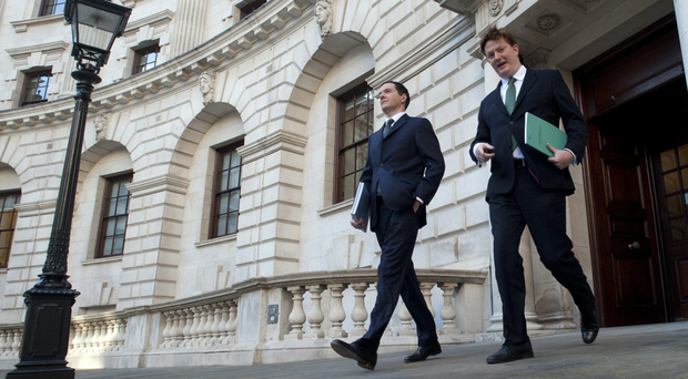 Chancellor George Osborne and Chief Secretary of the Treasury Danny Alexander leaving The Treasury for Parliament yesterday