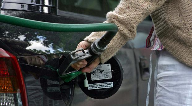 The cost of filling up a car with petrol is £2 less than a month ago
