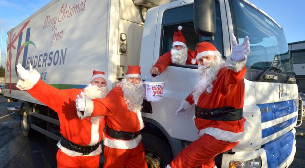 Henderson Foodservice managing director Damien Barrett with fellow Santas Michael Lappin, Peter Taylor and Andy McDonald, who embarked on over 30 delivery lorries to visit customers and drum up donations for the Northern Ireland Children's Hospice.