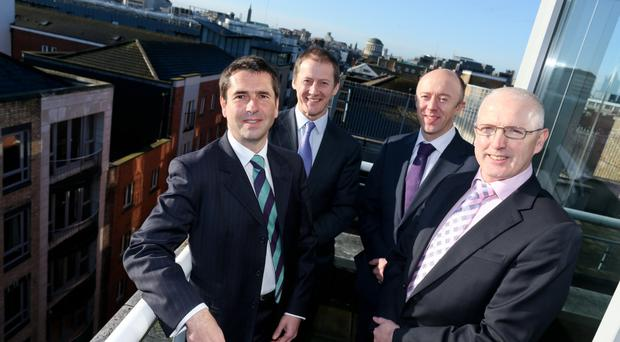 From left, Tony Bird, founder and CEO of Patech Solutions Ltd, with Justin Keatinge, Tom O'Connor, and Jarlath Dooley of Version 1