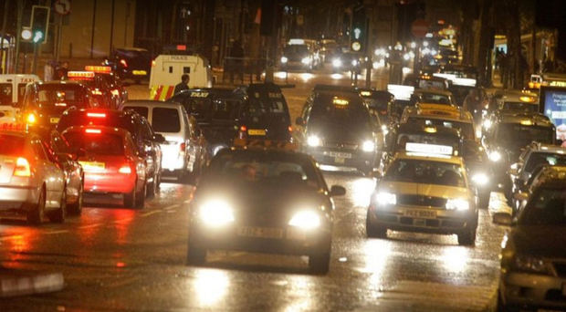 Great Victoria Street in Belfast city centre teems with taxis serving the night-time economy
