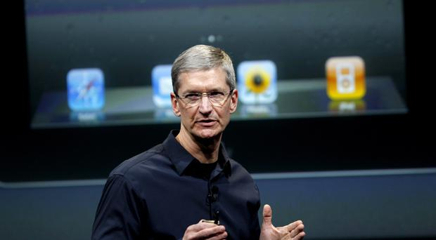 Apple CEO Tim Cook is delighted with record profits due to success of the iPhone
