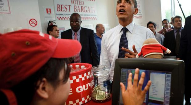 US president Barack Obama places an order during a visit to Five Guys